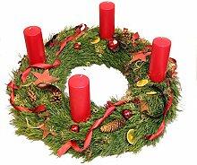 Adventskranz mit roten Stumpenkerzen und