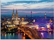 Artland Glasbild Köln Panorama am Abend,