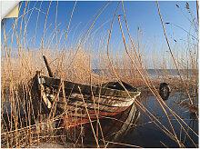 Artland Wandbild Ein altes Boot im Schilf 40x30