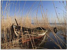 Artland Wandbild Ein altes Boot im Schilf 80x60