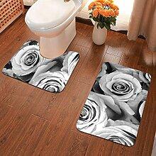 Badematte mit schwarzen und weißen Rosen,