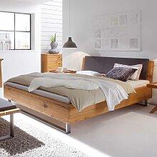 Bett aus Wildeiche Massivholz mit gepolstertem