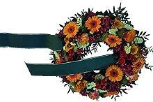 Blumiger Trauerkranz mit Trauerschleife von Flora