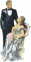 Brautpaar, Hochzeitspaar, Silber Hochzeit, Silberne Hochzeit | Silberpaar auf Sessel - Mann Stehend mit Blumen (Mann Hand in der Tasche)