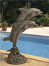 Bronzedelfine wasserspeiend