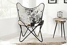 Casa Padrino Echtfell Designer Sessel Schwarz / Weiß - Relax Kuhfell Stuhl