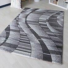 Designer Teppich in Schwarz mit abstrakten geometrischem Design in Kurzflor Grau Wellen Muster für Wohnzimmer und Schlafzimmer (200 x 290 cm)
