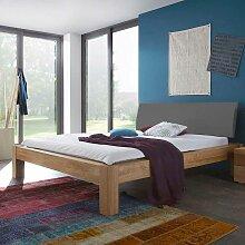 Doppelbett aus Wildeiche massiv honigfarben geölt Polsterkopfteil in Grau