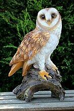 Eule auf Stamm Uhu Kauz Vogel Gartenfigur