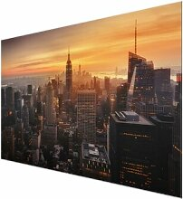 Glasbild Manhattan Skyline in der Abenddämmerung