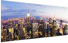 Glasbild New York Skyline bei Nacht East Urban Home