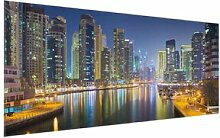 Glasbild Skyline von Dubai bei Nacht East Urban