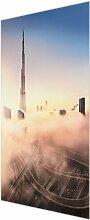 Glasbild Skyline von Dubai East Urban Home