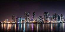 Glasbild Stadt-Silhouette Ebern Designs