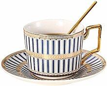 Goldene gestreifte Keramik-Kaffeetasse und