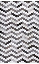 Handgefertigter Teppich Deven aus Kuhfell in Grau
