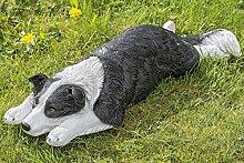 Hund Ralph schwarz-weiß liegend Kunstharz (1002644) Gartenfigur Gartendeko