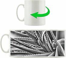 Kaffeebecher Grüne Pflanze mit Wassertropfen