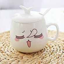 Keramikbecher Mit Griff Mit einem Decklöffel