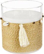 Kerze im Glasbehälter mit Pompons und Muscheln