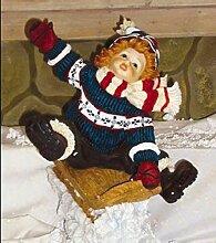 Kind auf Schlitten - Weihnachtsfiguren - WN303