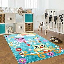 Kinder Teppich für das Kinderzimmer Öko Tex 100 2773 freundliche eulen auf dem ast mit regenbogen türkis 120x160 cm