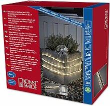 Konstsmide 3746-100 LED Lichterschlauch 18m / für Außen (IP44) /  Batteriebetrieben: 4xD 1.5V (exkl.) / mit Lichtsensor, 6h und 9h Timer / 288 warm weiße Dioden / transparenter Schlauch