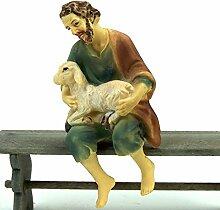 Krippenfigur aus Polyresin. Hirte mit Schaf,
