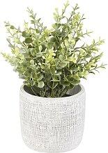 Künstliche Pflanze im Topf aus Zement