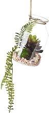 Künstliche Pflanze in Glaskugel