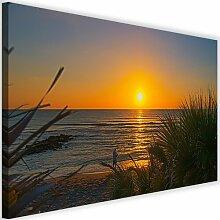Leinwandbild Angler bei Sonnenuntergang