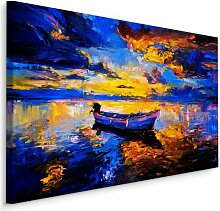 Leinwandbild Ein Boot im Sonnenuntergang