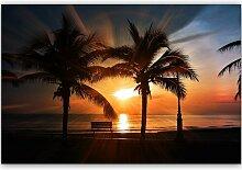 Leinwandbild Palmen am Meer bei Sonnenuntergang