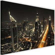 Leinwandbild Panorama von Dubai bei Nacht