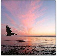 LeinwandbildSonnenuntergang mit Pelikan