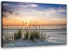 Leinwandbild Sonnenuntergang über dem Strand