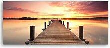 Leinwandbild Sonnenuntergang über der Brücke