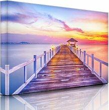 Leinwandbild Steg ins Meer bei Sonnenuntergang