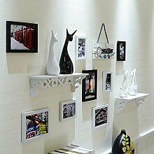 Lx.AZ.Kx Bilderrahmen an der Wand mit Uhren