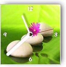 Motivx Wanduhr mit Motiv Steine mit pinker Blume