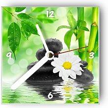 Motivx Wanduhr mit Motiv Steine mit weißer Blume