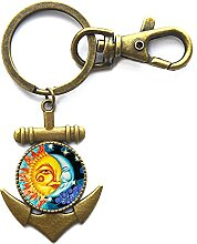 Schlüsselanhänger aus Glas mit Cabochon Mond und