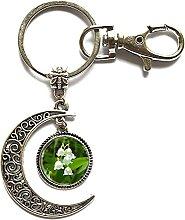 Schlüsselanhänger aus Glas mit Mond und Lilie,