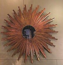 Spiegel mit Rahmen in Sonnen-Optik