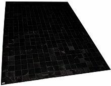 Suggaloaf Patchwork Teppich aus schwarzem Kuhfell
