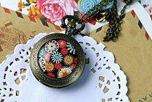 Taschenuhr mit vielen Blumenmotiven,