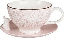 Tasse und Untertasse aus rosa Porzellan mit