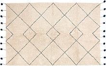 Teppich aus natürlicher Baumwolle und Bommeln