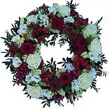 Trauerkranz mit Rosen in rot und weiß von Flora