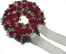 Trauerkranz mit roten Rosen von Flora Trans